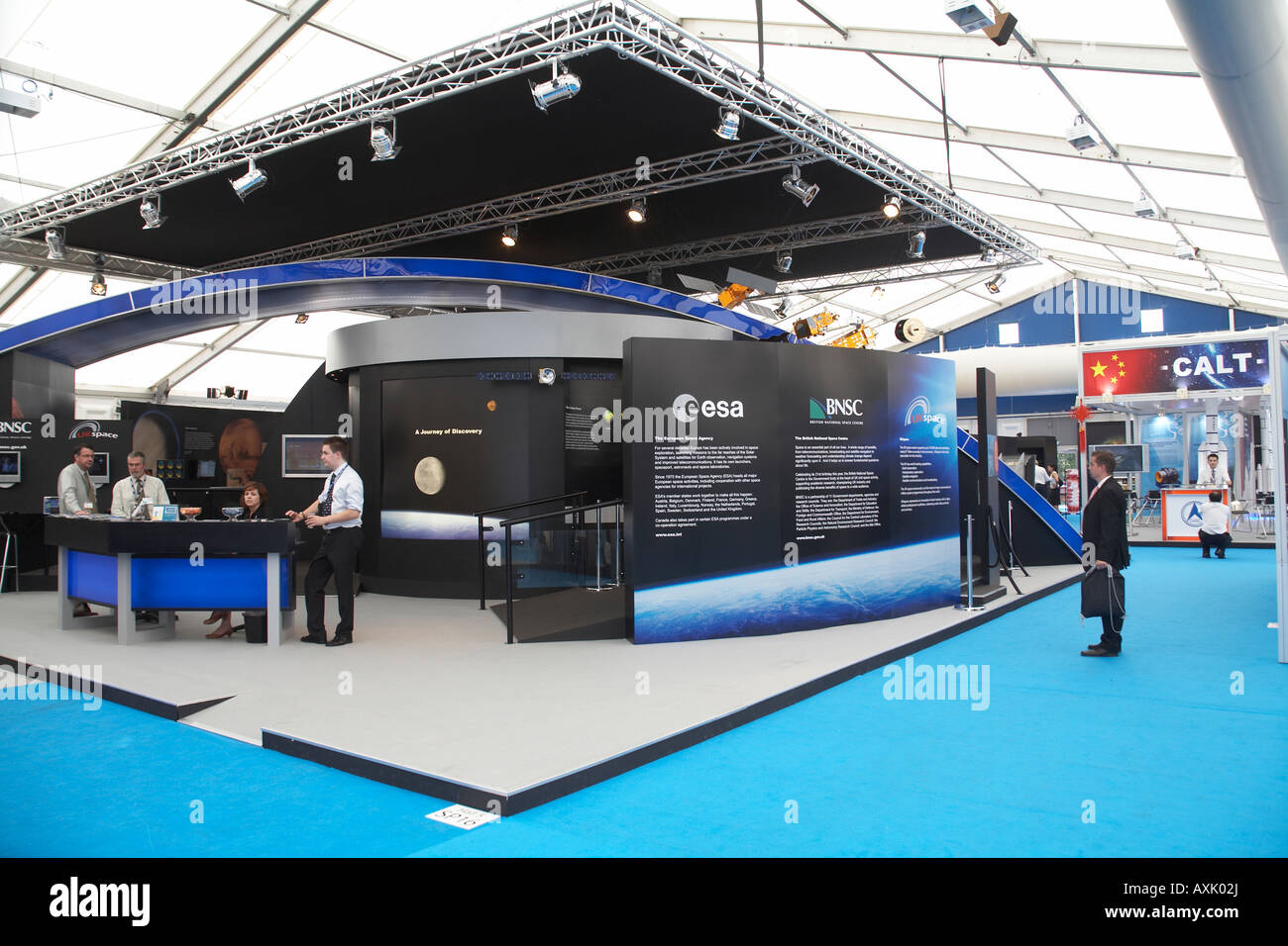 European Space Agency esa exhibition display trade show stand with visitors at Farnborough International Airshow - Stock Image