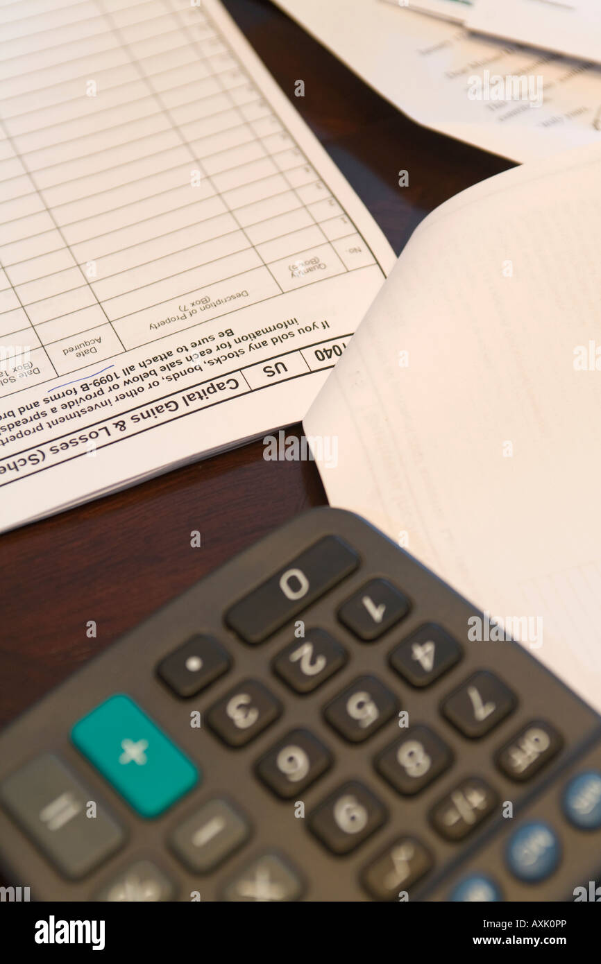 ILLINOIS Riverwoods Calculator and tax forms for income tax preparation financial documents capital gains and losses - Stock Image