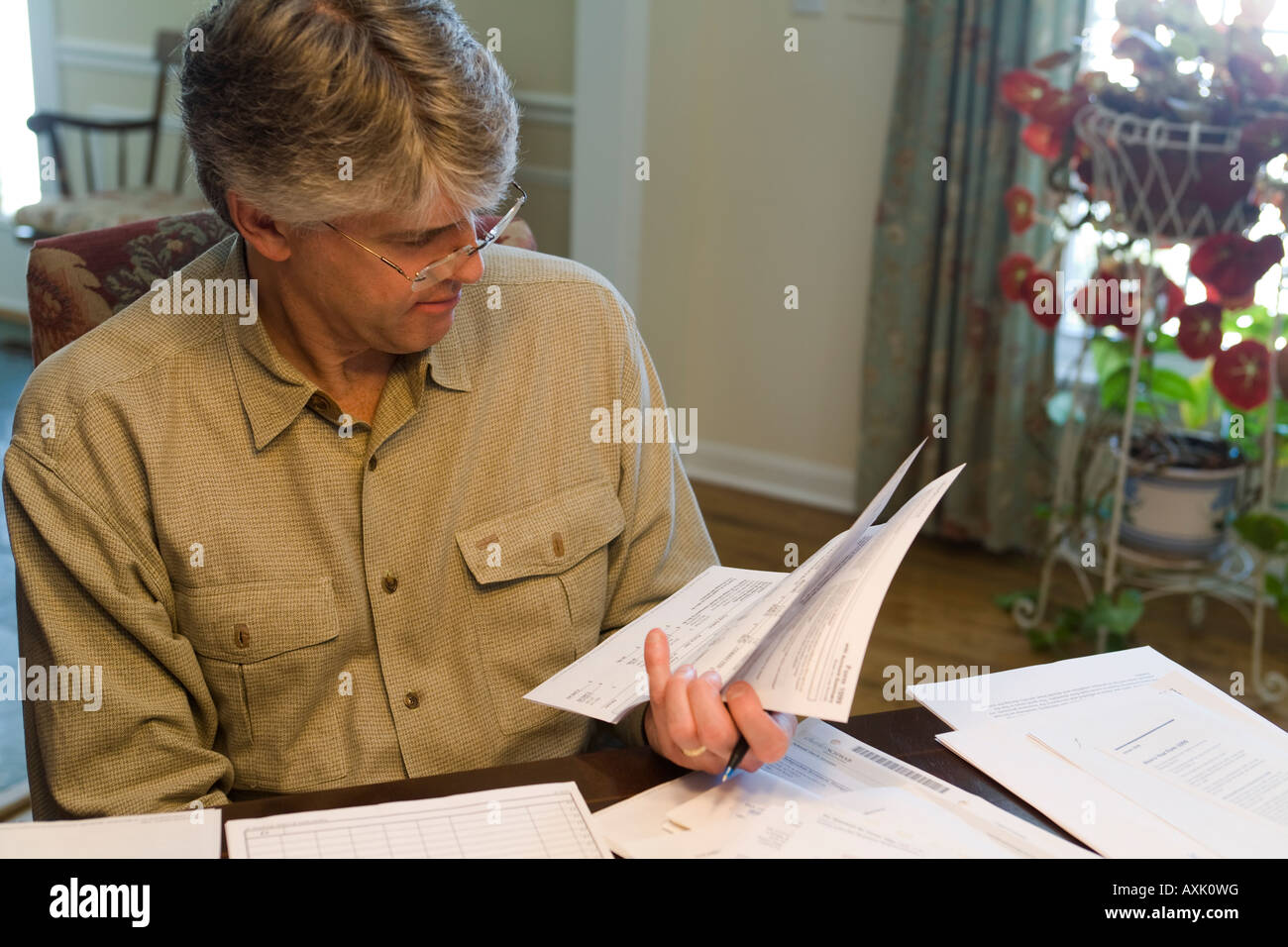 ILLINOIS Riverwoods Adult male reviewing forms for income