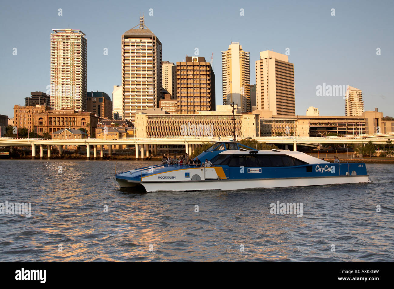 Central Business District buildings with City Cat ferry in evening summer sunlight with river Brisbane Queensland Stock Photo