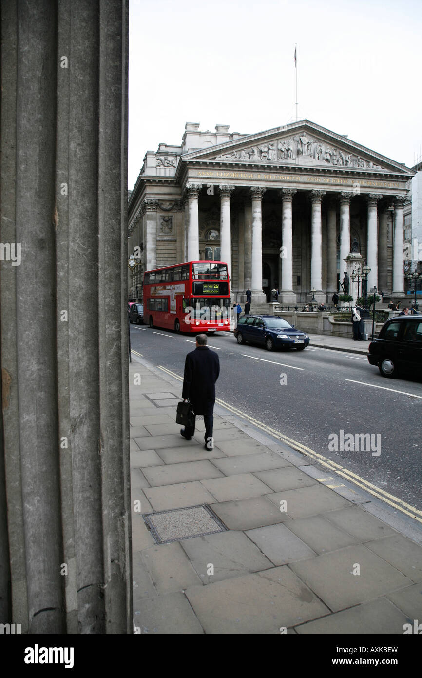 View of Royal Exchange and Threadneedle Street from behind a column of the Bank of England, The City of London - Stock Image
