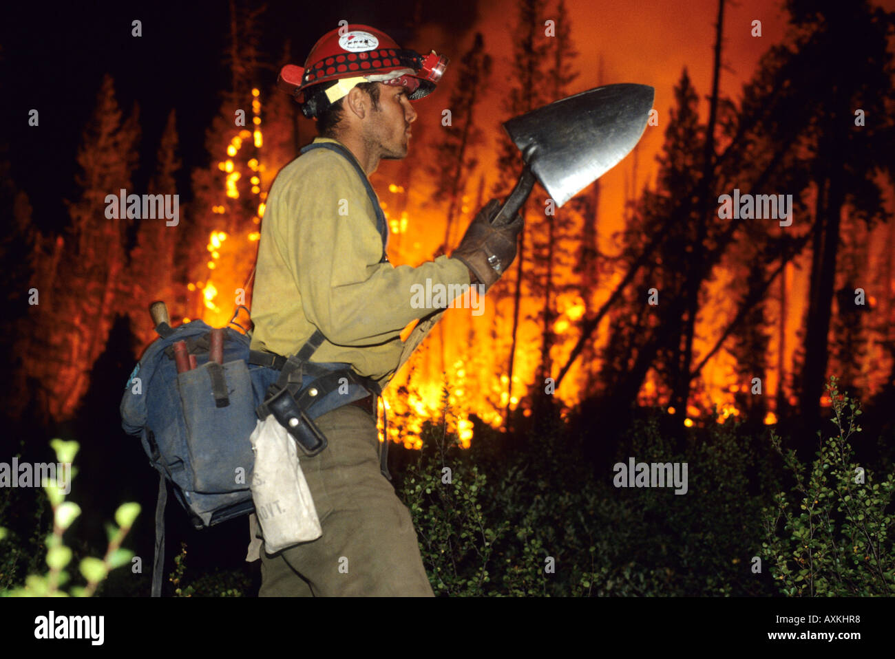 A firefighter working to put out the Cub Creek forest fire near Lowman Idaho - Stock Image