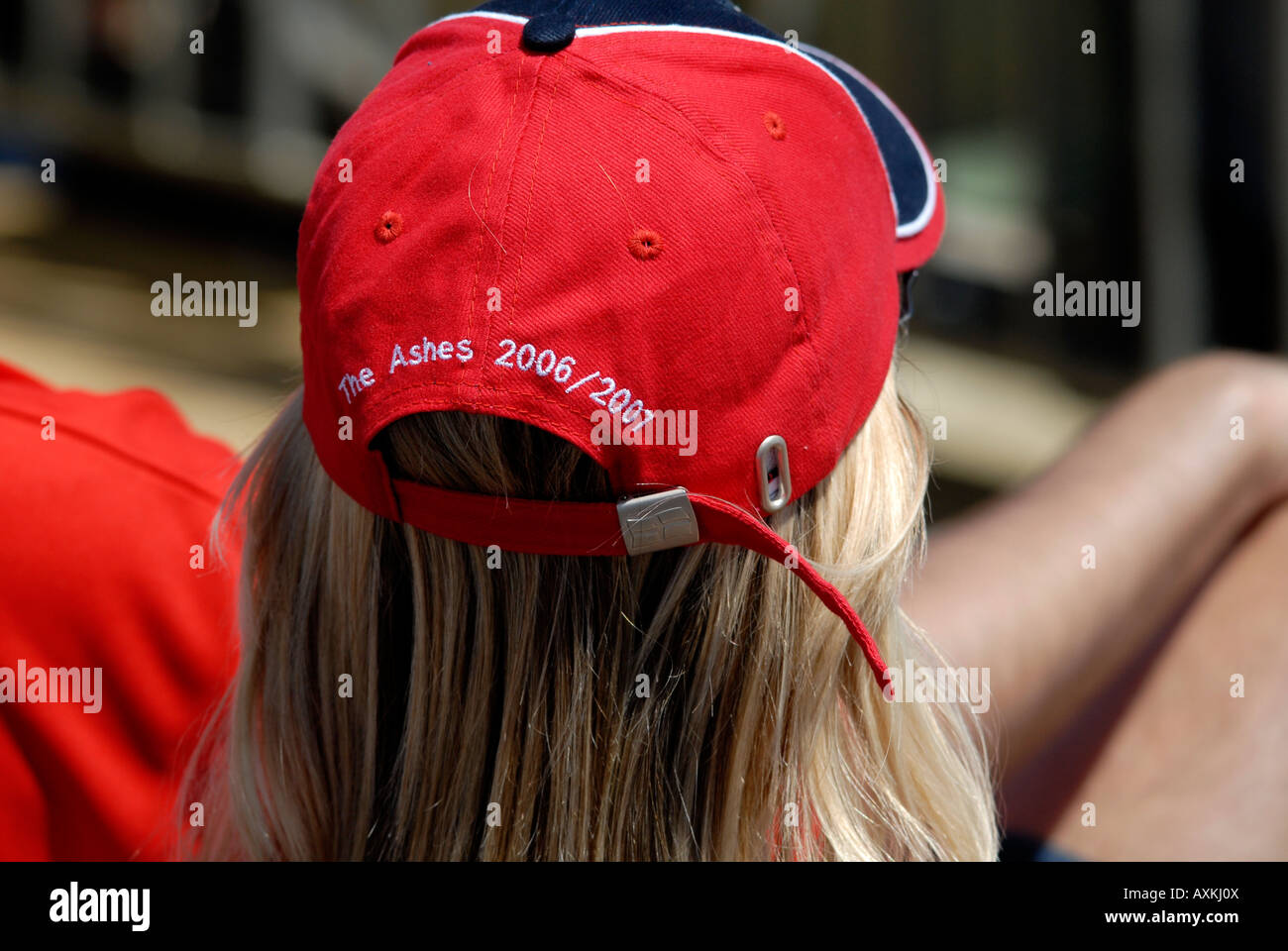887c1200 Rear view of female England fan at Test Cricket match, wearing hat with  English colours