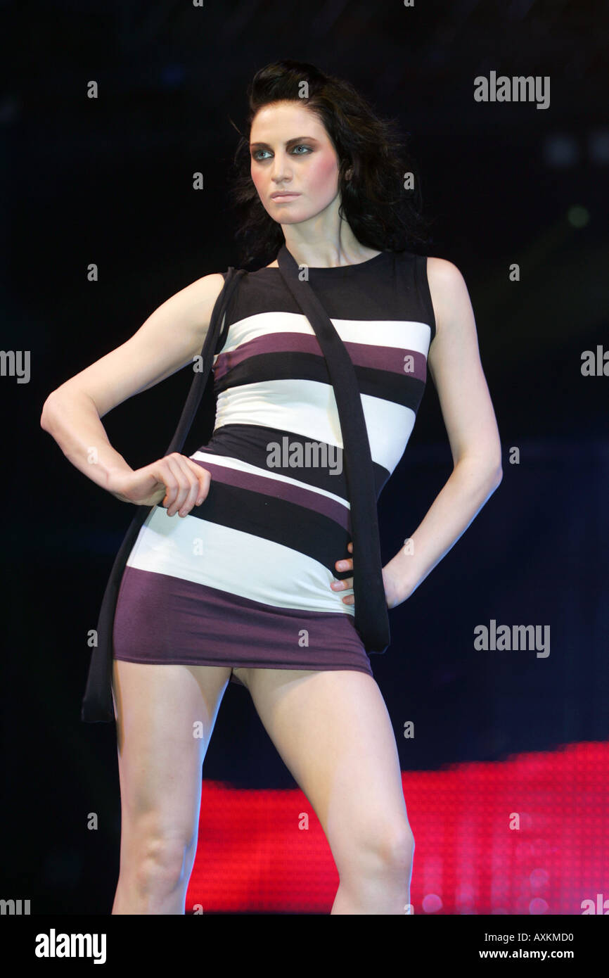Model wearing stripey minidress at the Clothes Show NEC Birmingham December 2005 - Stock Image