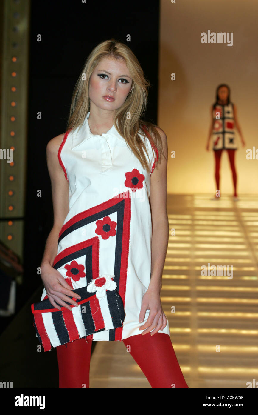 Model wearing white black & red 1960's style minidress at the Clothes Show NEC Birmingham December 2005 - Stock Image