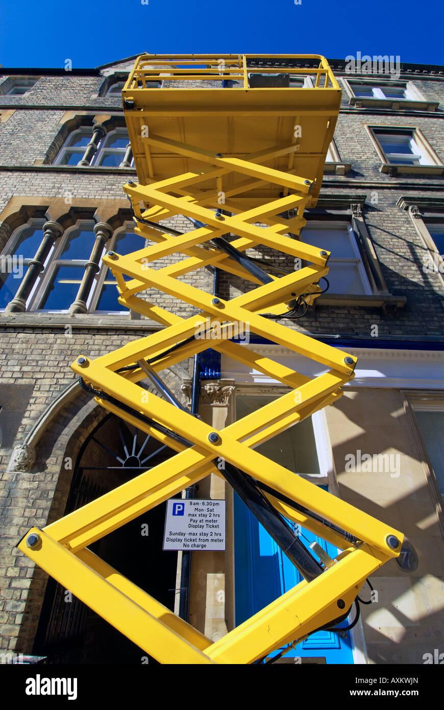 A hydraulic scissor lift platform at work in King Edward