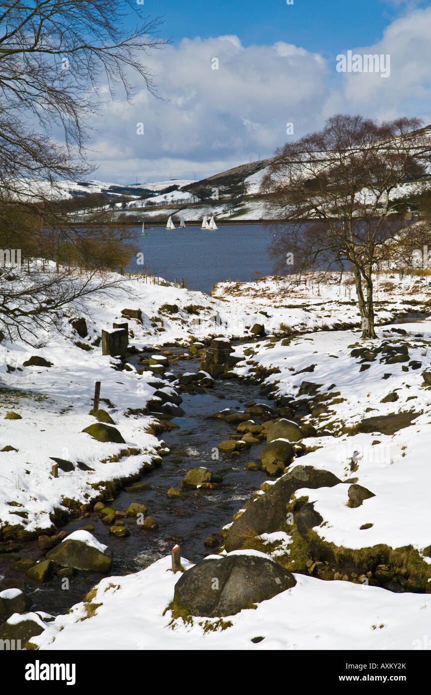 Dovestones reservoir and Chew Brook with snow - Stock Image