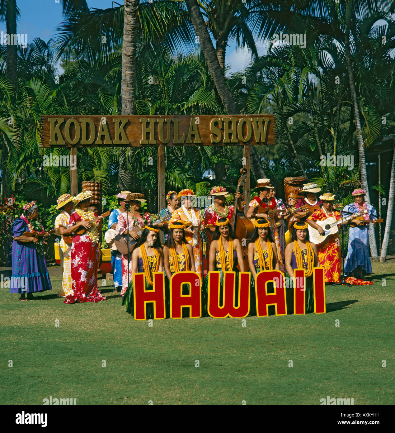 Large group of Hawaiian dancers and singers entertain with guitars ukuleles at The Kodak Hula Show in Waikiki Honolulu - Stock Image