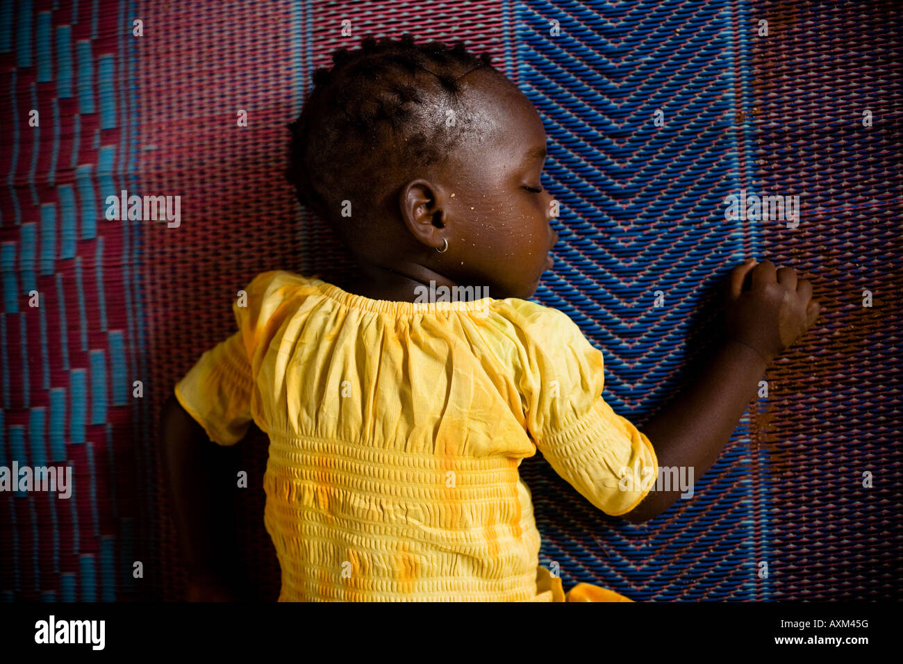 Girl Sleeping On Floor Mat Benin Africa Stock Photo 16873083