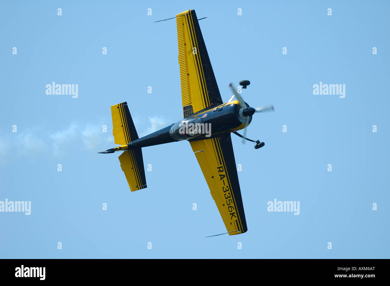 Yak 55 Russian and aerobatic plane turning a barrel, french airshow at La Ferte Alais,, France - Stock Image