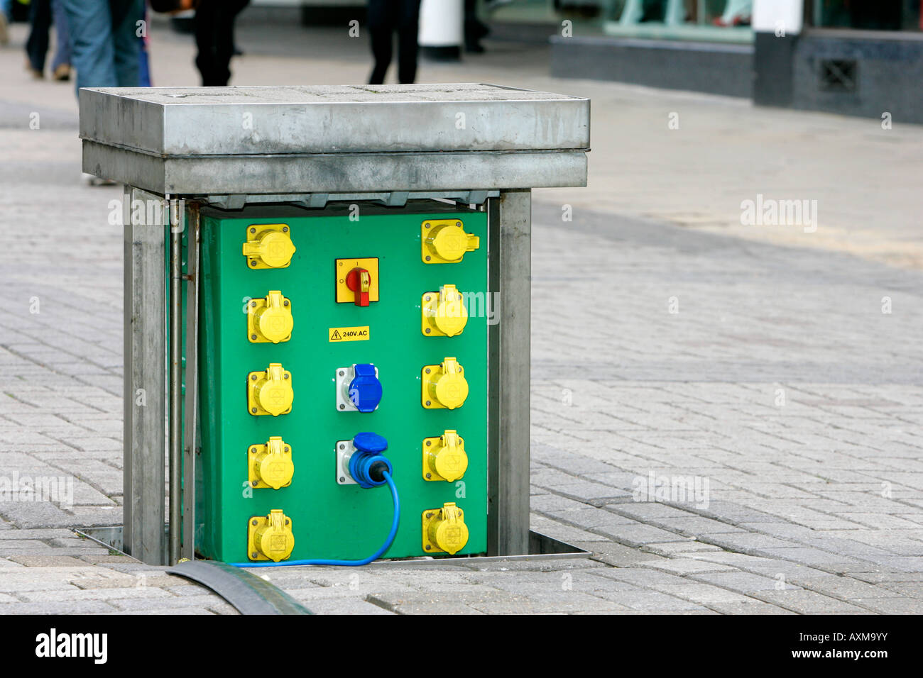 Distribution point electricity power box green out site street electrical electrocution connection pedestrian zone Stock Photo