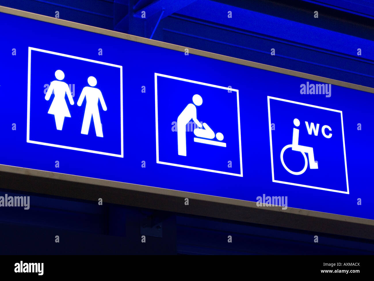 Sign showing different toilet facilities at airport. - Stock Image