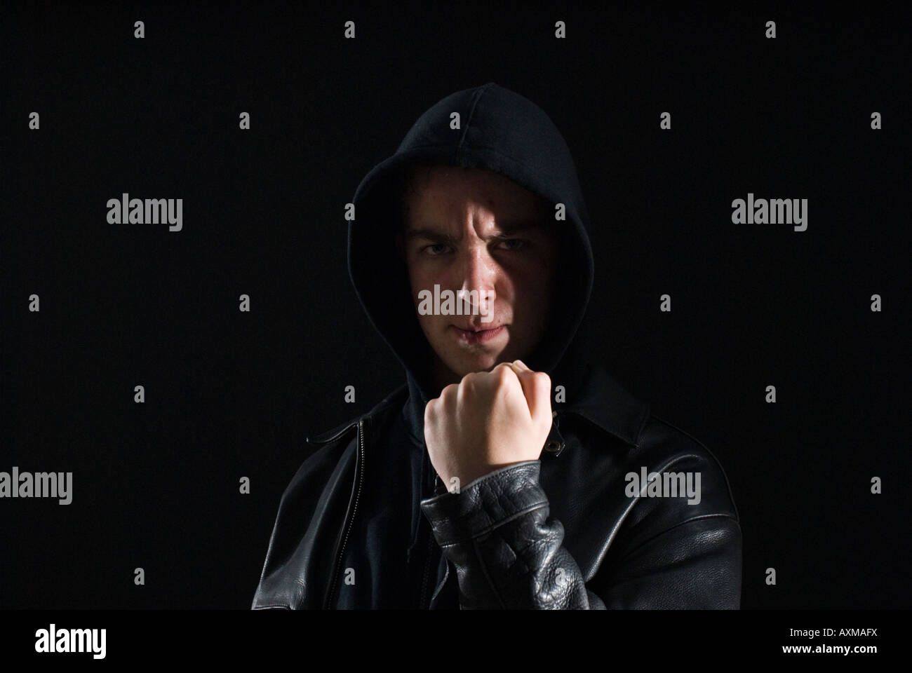 Teenage lout threatening with fist - Stock Image