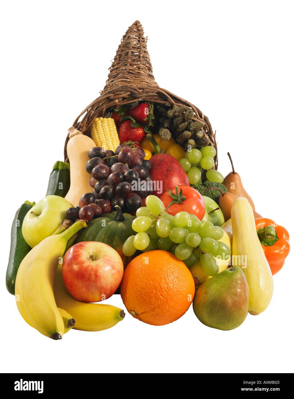 Studio shot of cornucopia with fruit - Stock Image