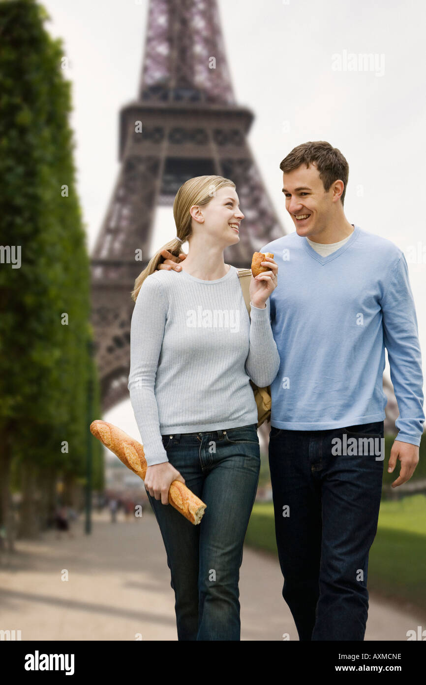 Couple walking with Eiffel Tower in background Stock Photo