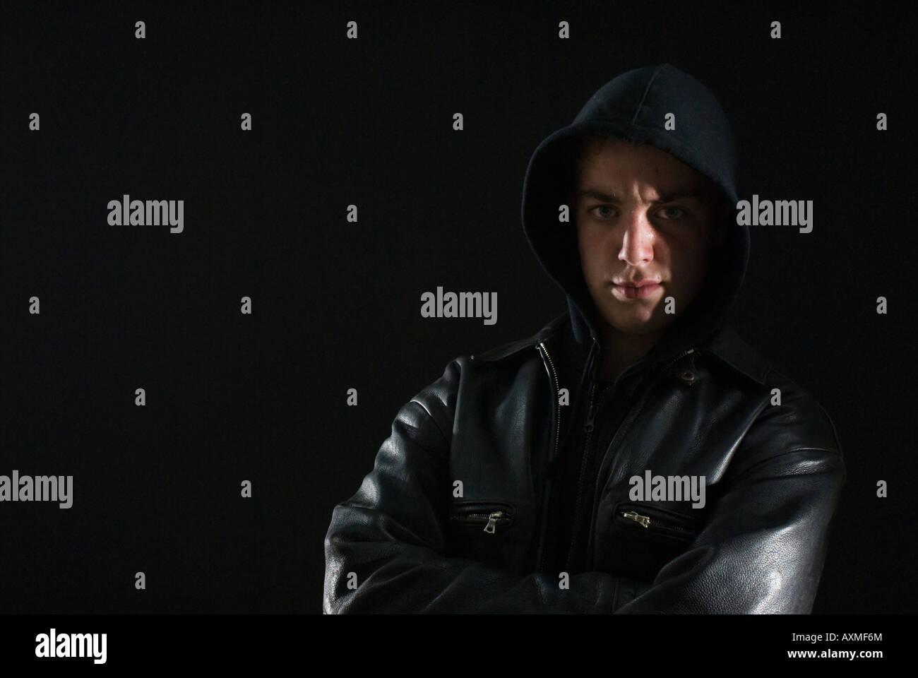 Menacing teenage boy in hoody - Stock Image