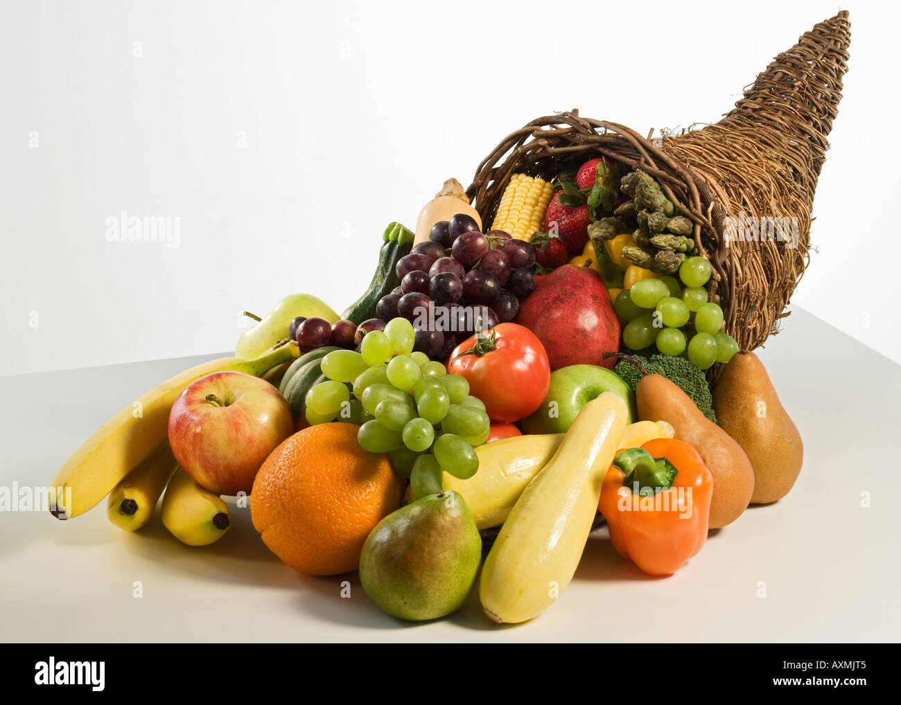 Fruits and vegetables in cornucopia basket - Stock Image