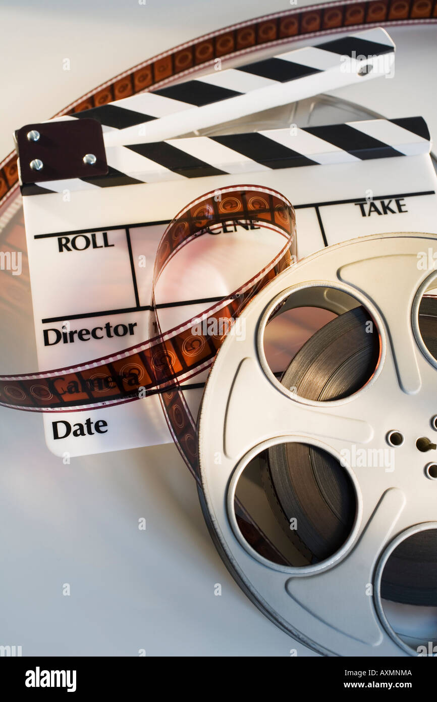 Movie reel with film and clapboard - Stock Image