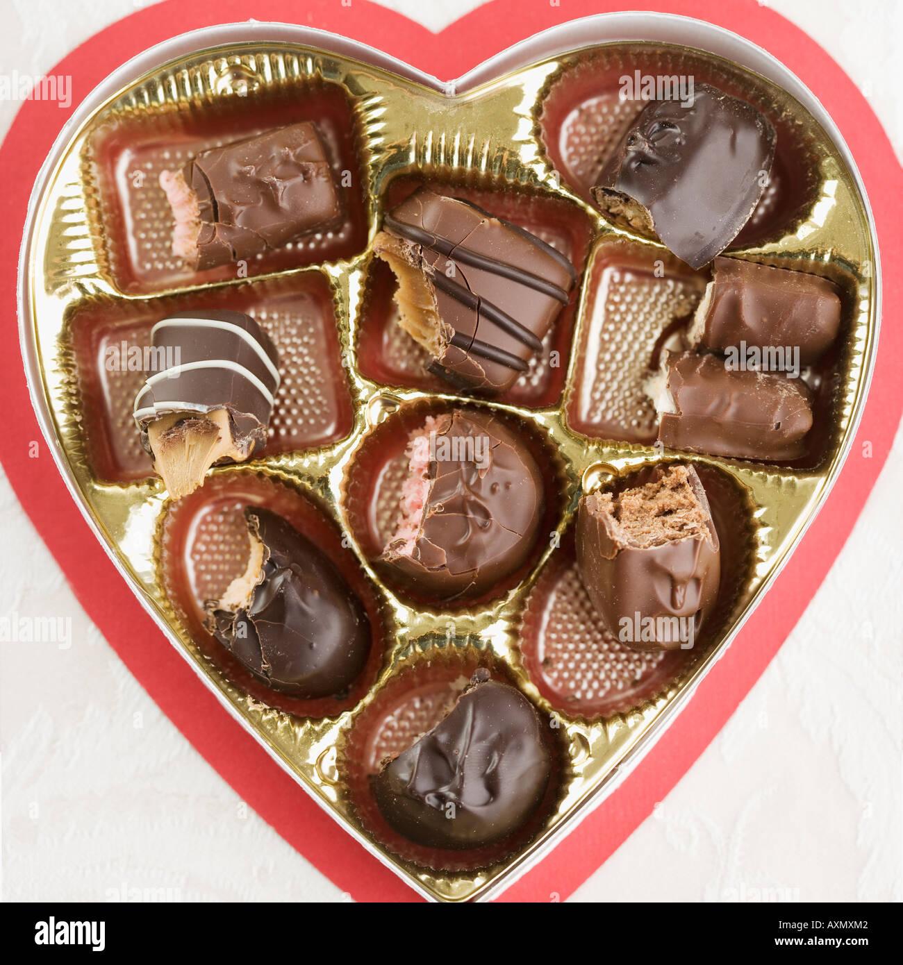 Still life of heart shaped box of chocolates Stock Photo