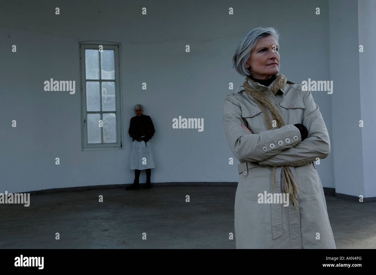 Two mature women standing in an empty room Stock Photo