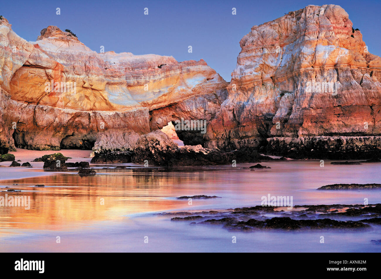 Rock formations at the beach Praia do Vau, Portimao, Algarve, Portugal - Stock Image