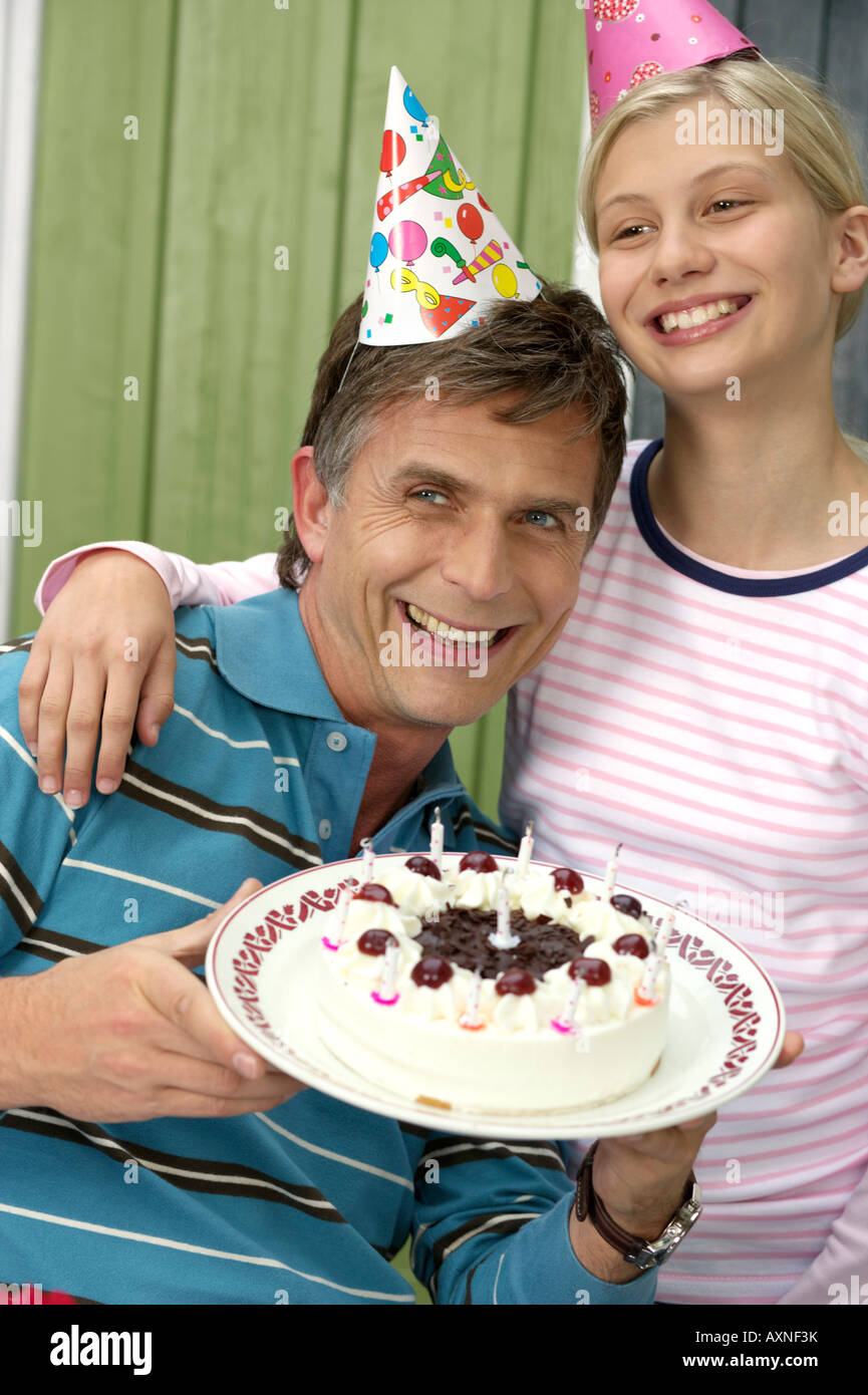 Mature Man With A Birthday Cake In His Hand Next To His Blond Stock