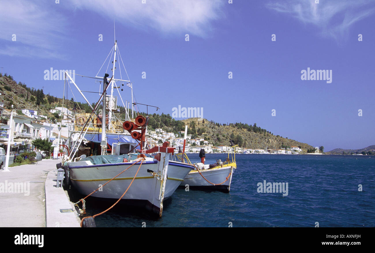 Fishing boats at harbour Buildings behind Sea Argo Saronic Islands - Stock Image