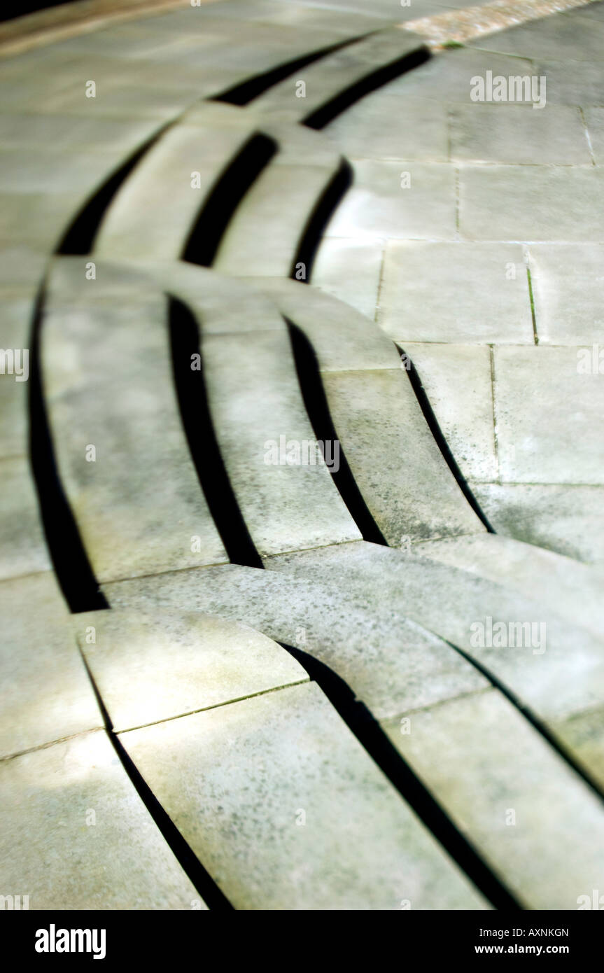 Tilt and shift lens stone sweeping grey steps at a cambridge college campus tourist attraction shadows - Stock Image