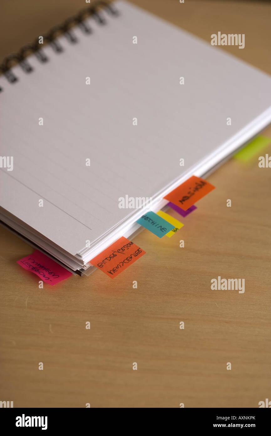 Self-adhesive notes at a notepad - Stock Image