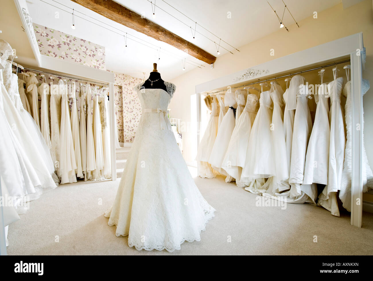 interior of wedding dress gown in bridal boutique shop stock