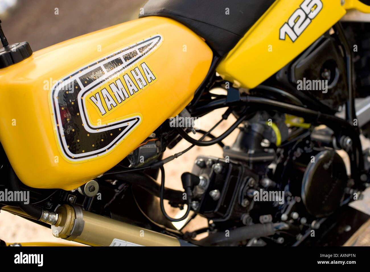 Yellow American fuel tank engine and seat from vintage twin-shock restored Yamaha YZ125H 1981 dirt bike motocross - Stock Image