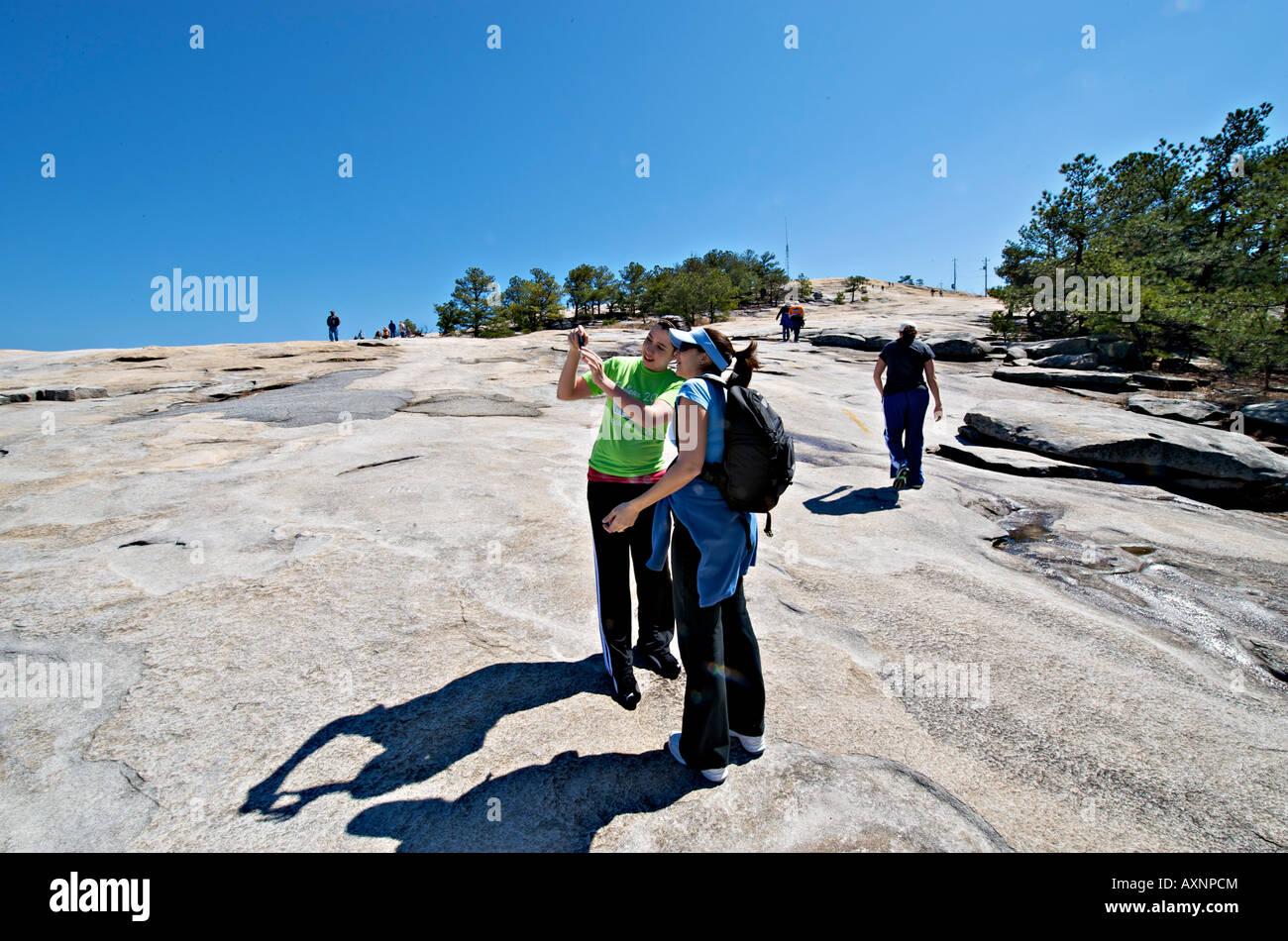 Tourists enjoy the walk to the summit of Stone Mountain Georgia - Stock Image