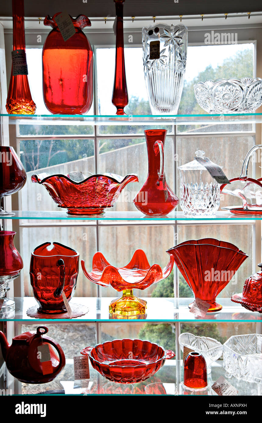 Display of antique glassware on sale at an antique shop - Stock Image