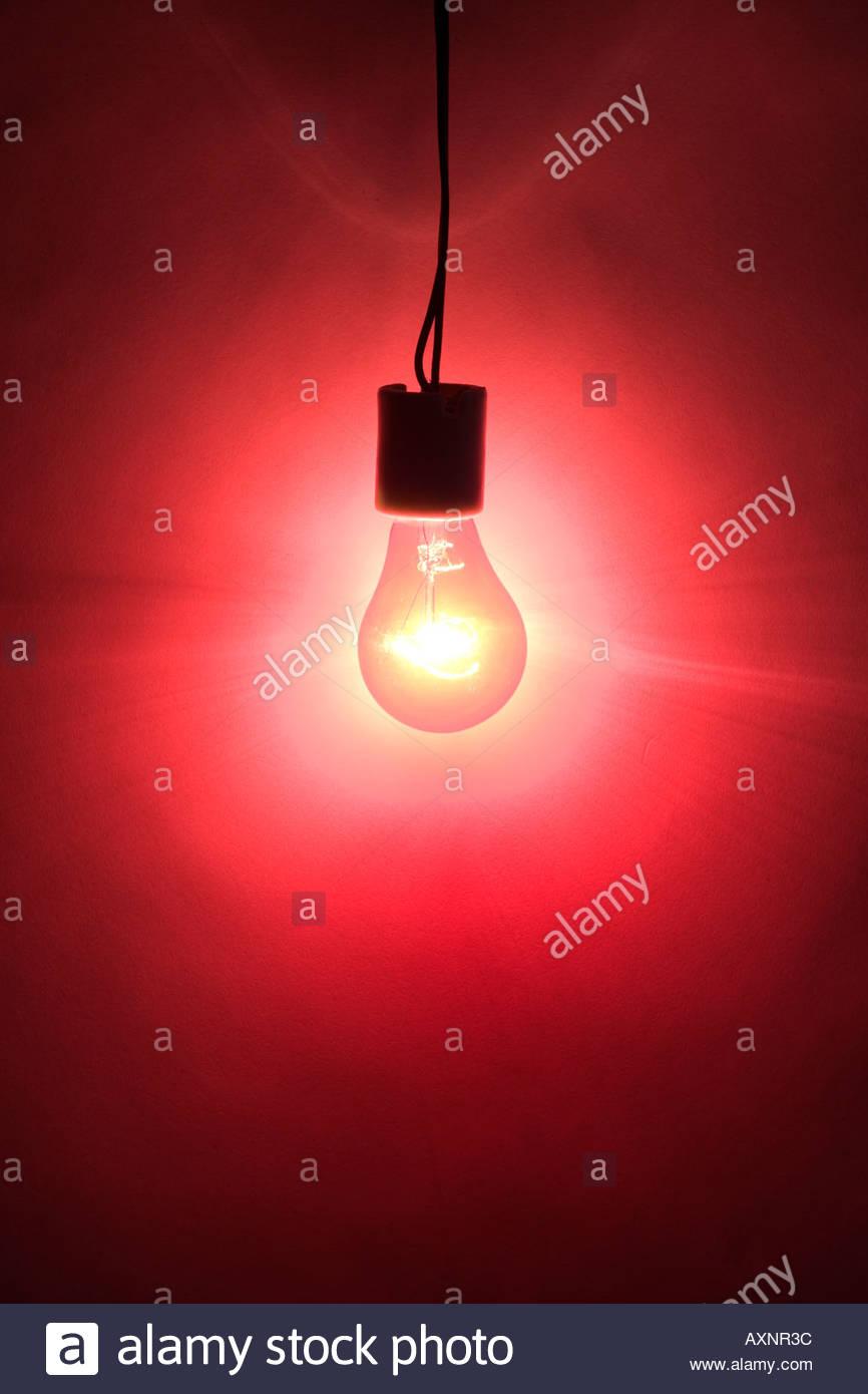 Light bulb filament hanging stock photos light bulb filament a red light forming an intense wall of light stock image aloadofball Gallery