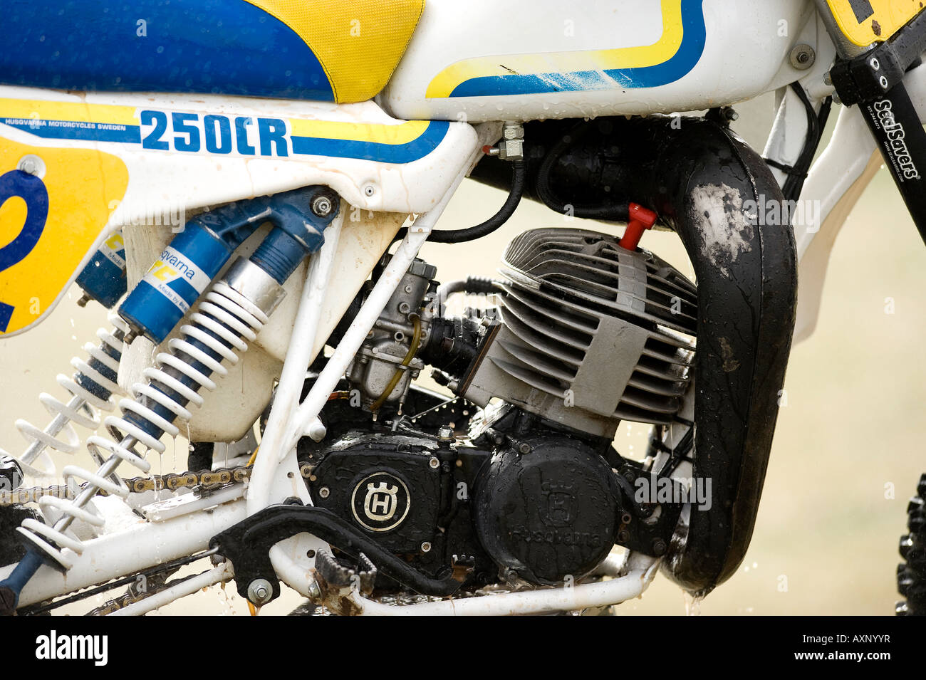 Twin shock vintage motocross muddy vintage 250CR Husqvarna Husky motocross with knobbly tyres tires twin-shock dirt - Stock Image