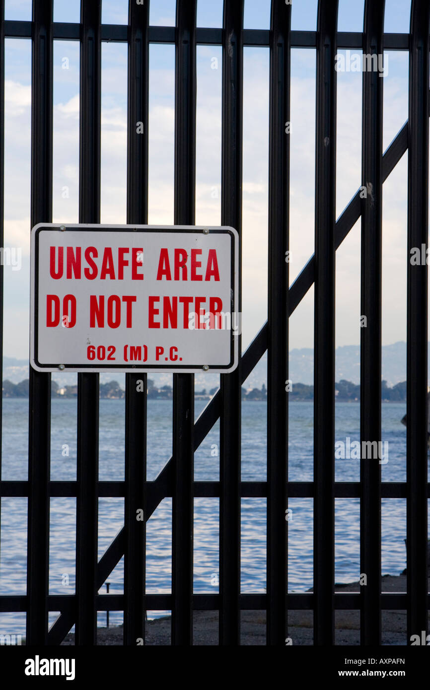 Fence and unsafe area sign San Francisco USA - Stock Image