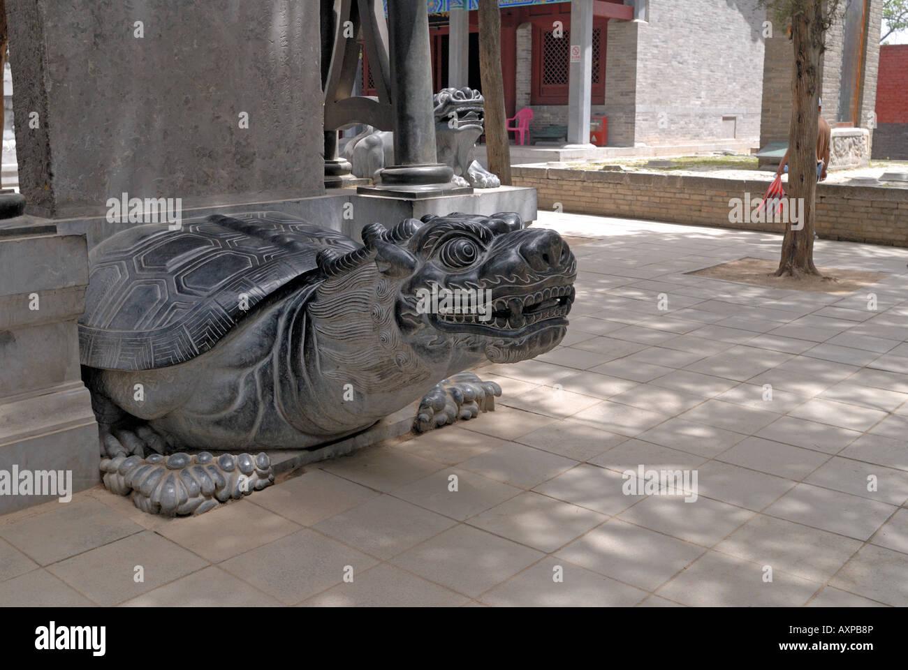 Stylised turtle at base of stele at Shaolin Buddhist Monastery Temple Henan Province Dengfeng Shaolin China Asia Stock Photo