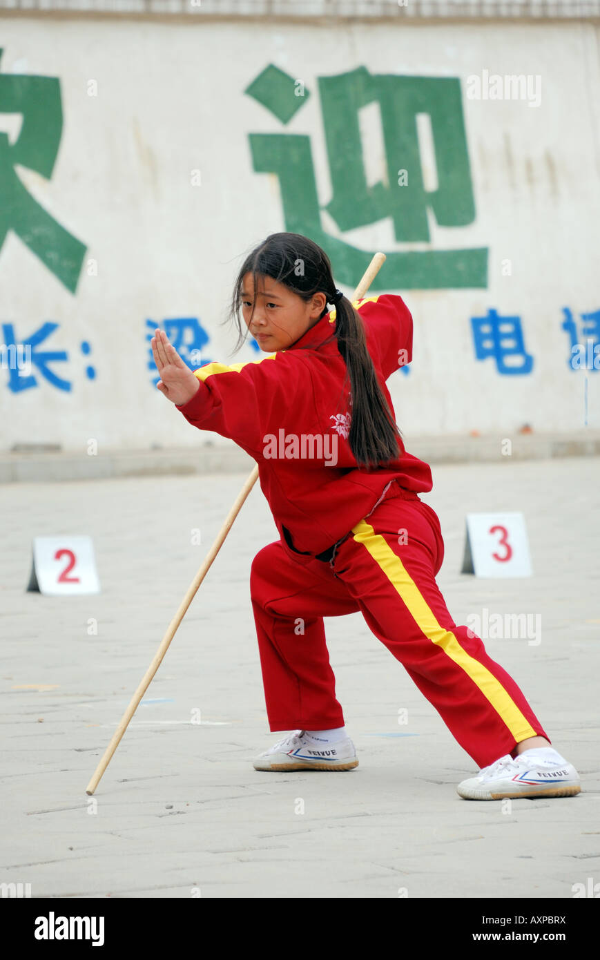 Girl training in Martial Arts Kung Fu at Shaolin Martial Arts School the  largest Martial Arts School in China Near Shaolin