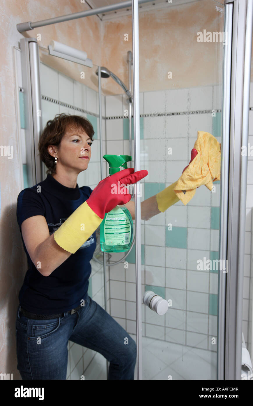 Household Woman is cleaning a bathroom - Stock Image