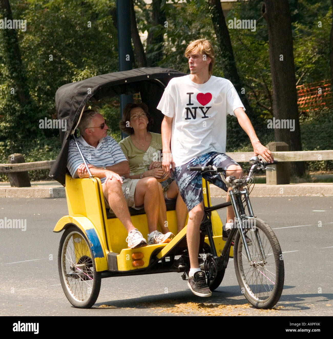 Tourists Getting A Ride From A Taxi Bike In Central Park
