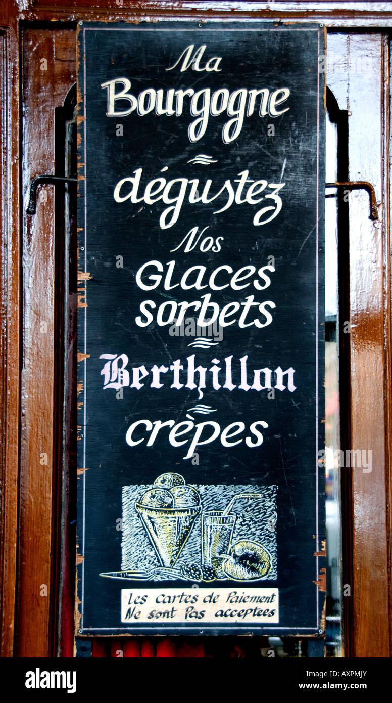 Marais Places des Vosges Burgundy terrace bar bistro cafe Paris France - Stock Image