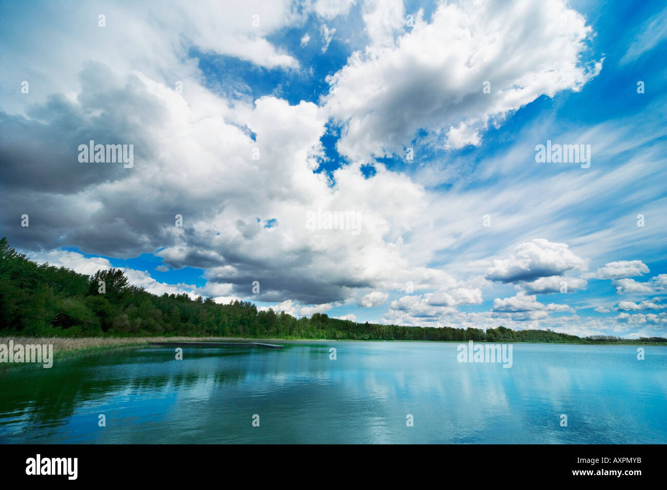 Cloud formation over body of water - Stock Image