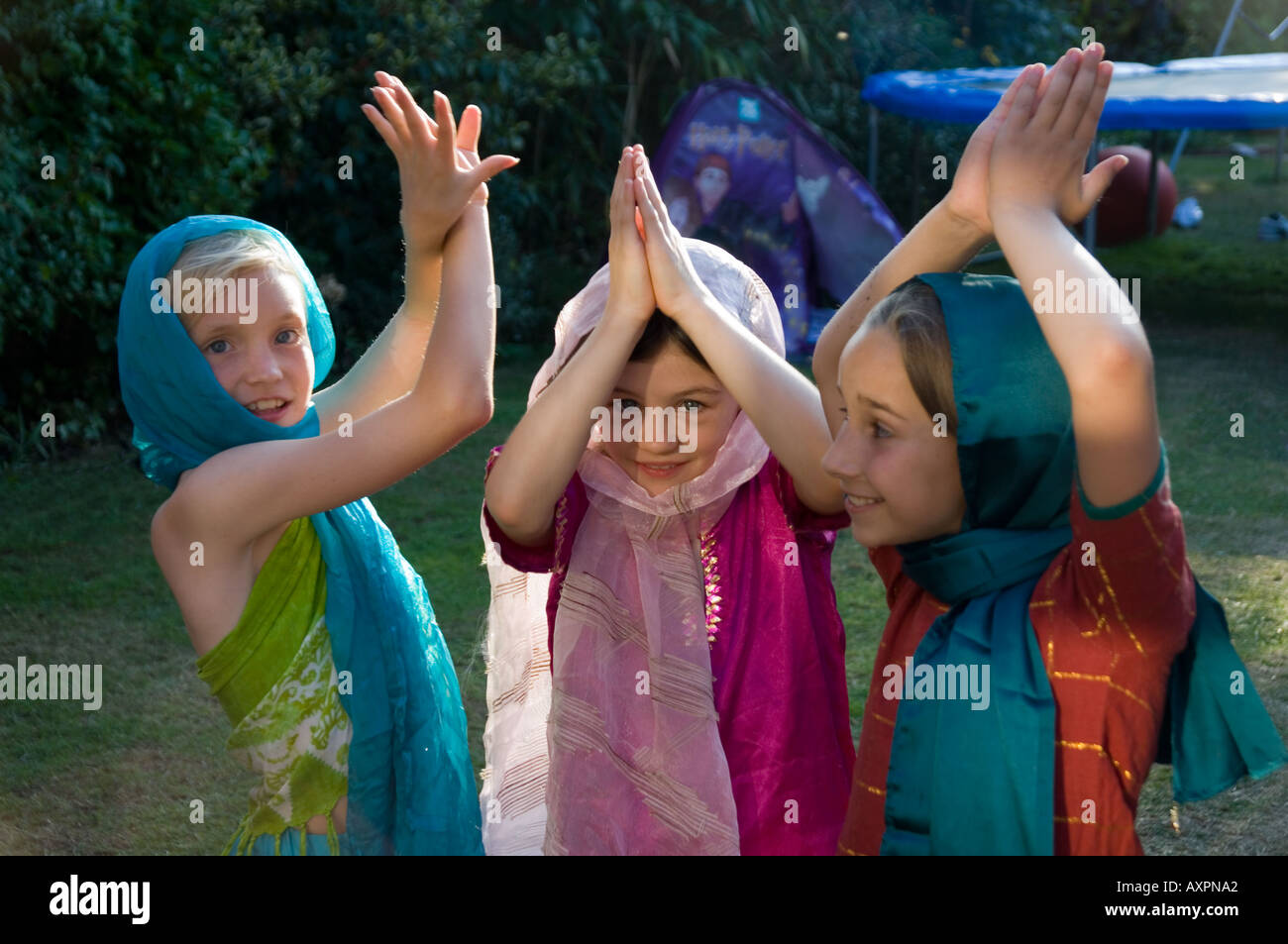 3 girls at play pretending to be indian princesses - Stock Image
