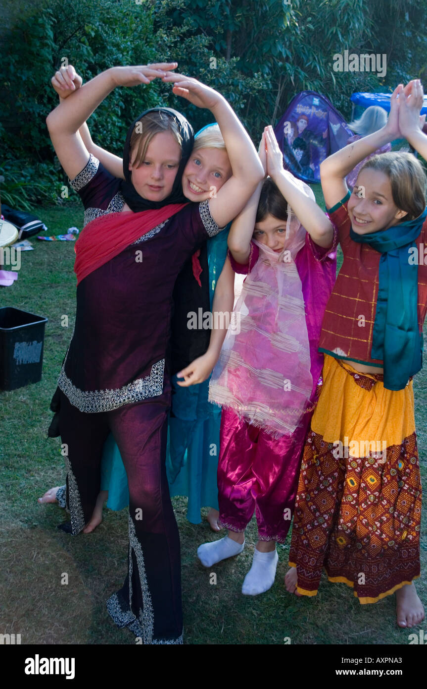 4 girls at play pretending to be indian princesses - Stock Image