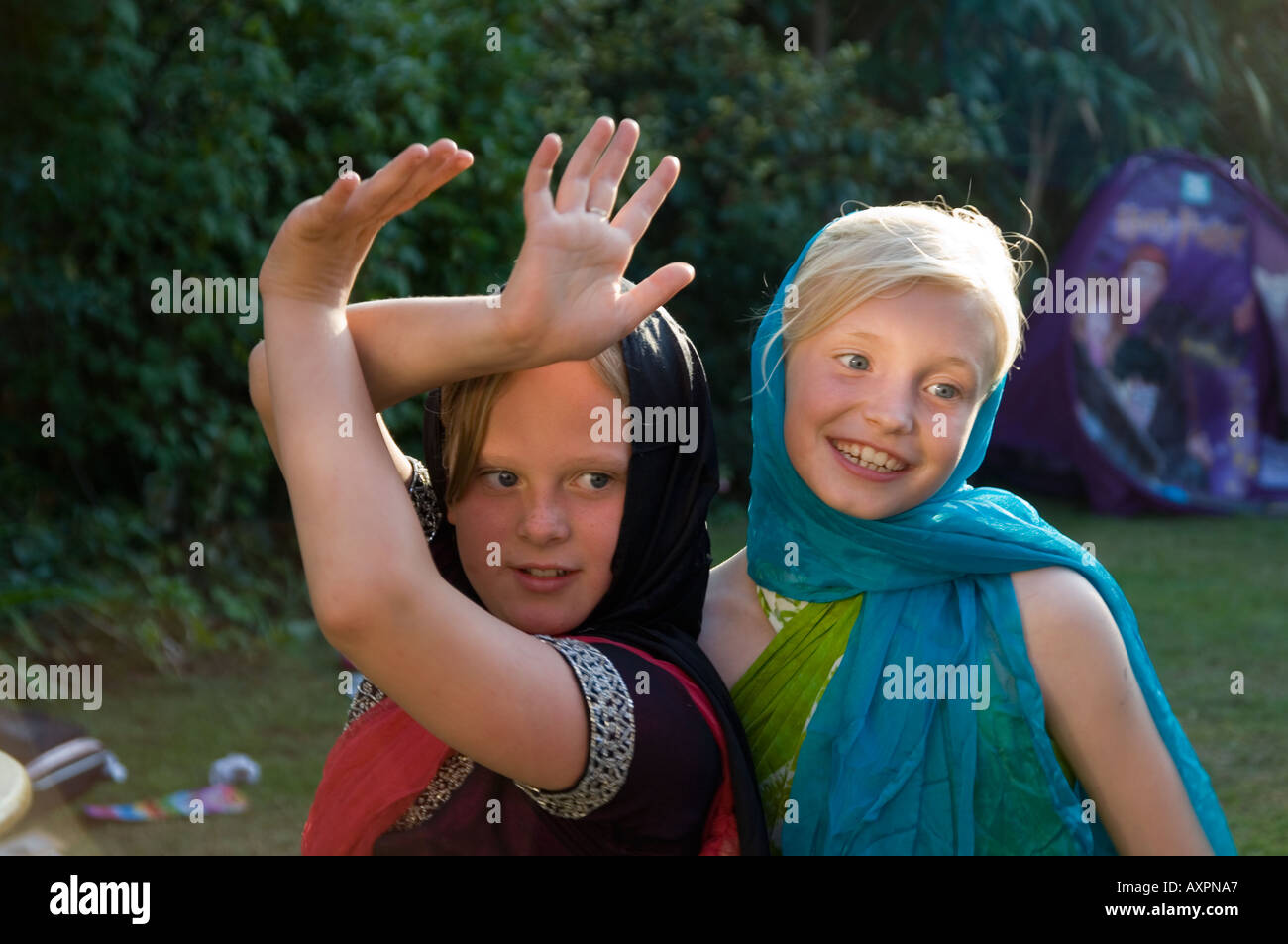 2 girls at play pretending to be indian princesses - Stock Image