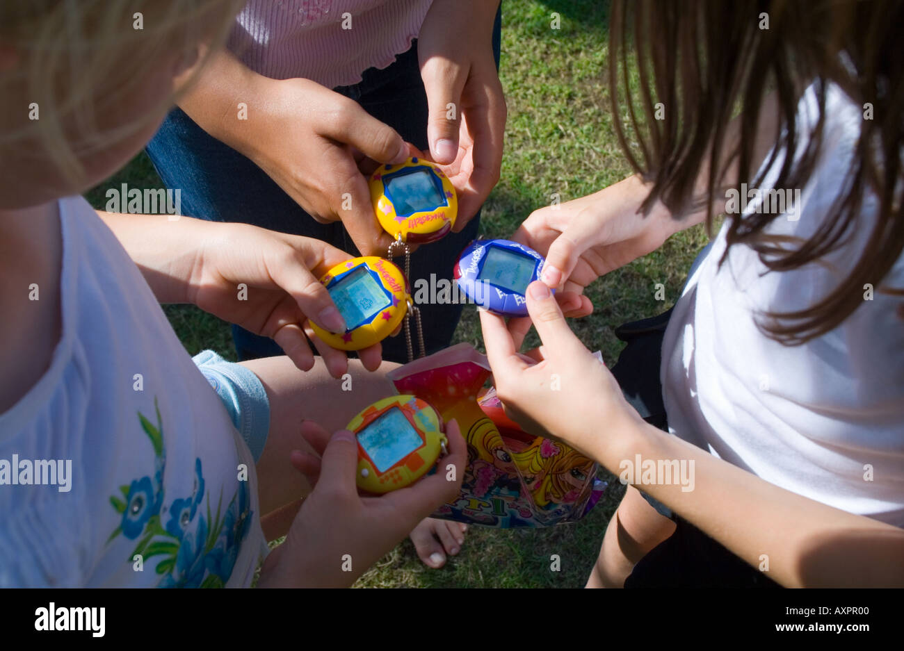 girls ten years old with tamagotchi toys - Stock Image