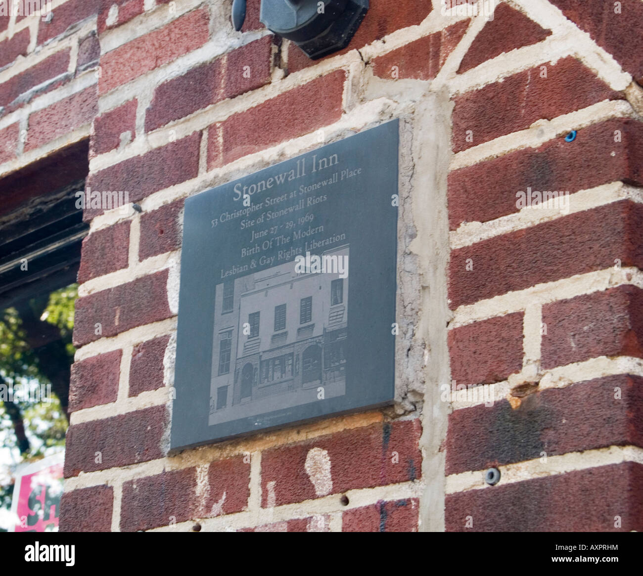 A plaque on the wall outside the Stonewall Inn on Christopher Street in the gay area of New York City USA - Stock Image