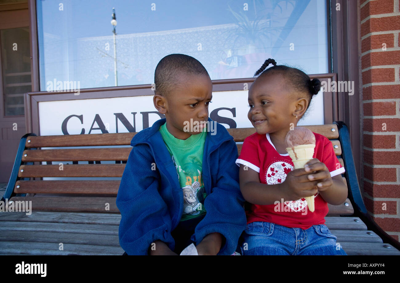 Boy and girl disagreeing over ice cream cone Stock Photo