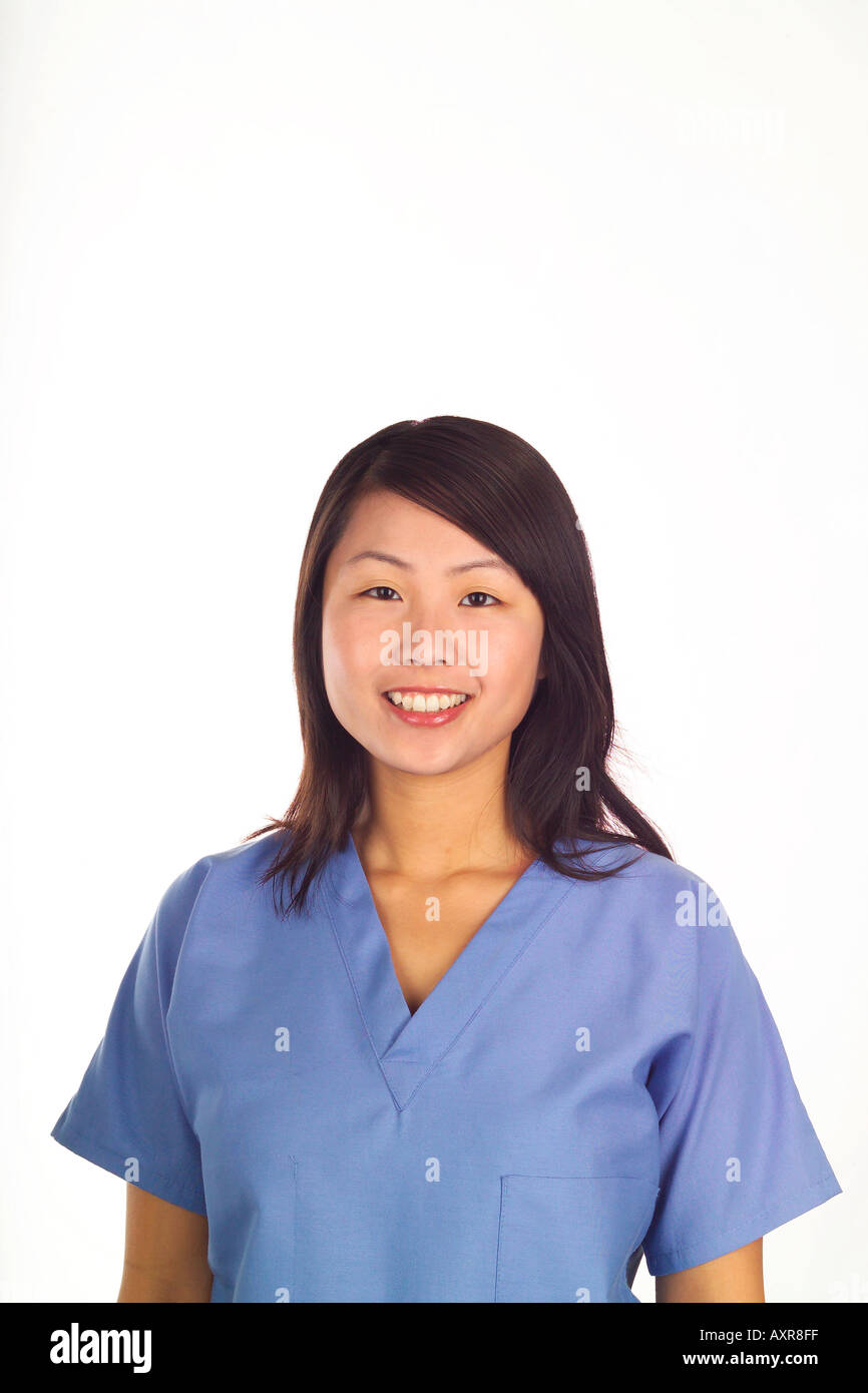 add4b1e7a84 Female Asian nurse or doctor dressed in blue surgical scrubs White  background