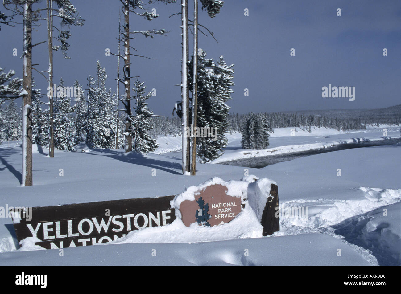 Snow Covered Yellowstone National Park Sign In Winter